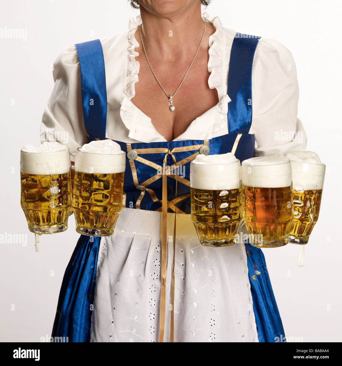 waitress WITH FIVE beer mugs, cut out, Muinch Bavaria GERMANY Europe - Stock Image