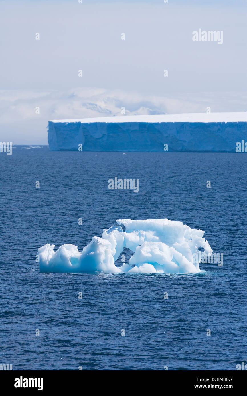 Sea ice and tabular icebergs shimmer in summer haze Antarctic Peninsula Antarctica - Stock Image