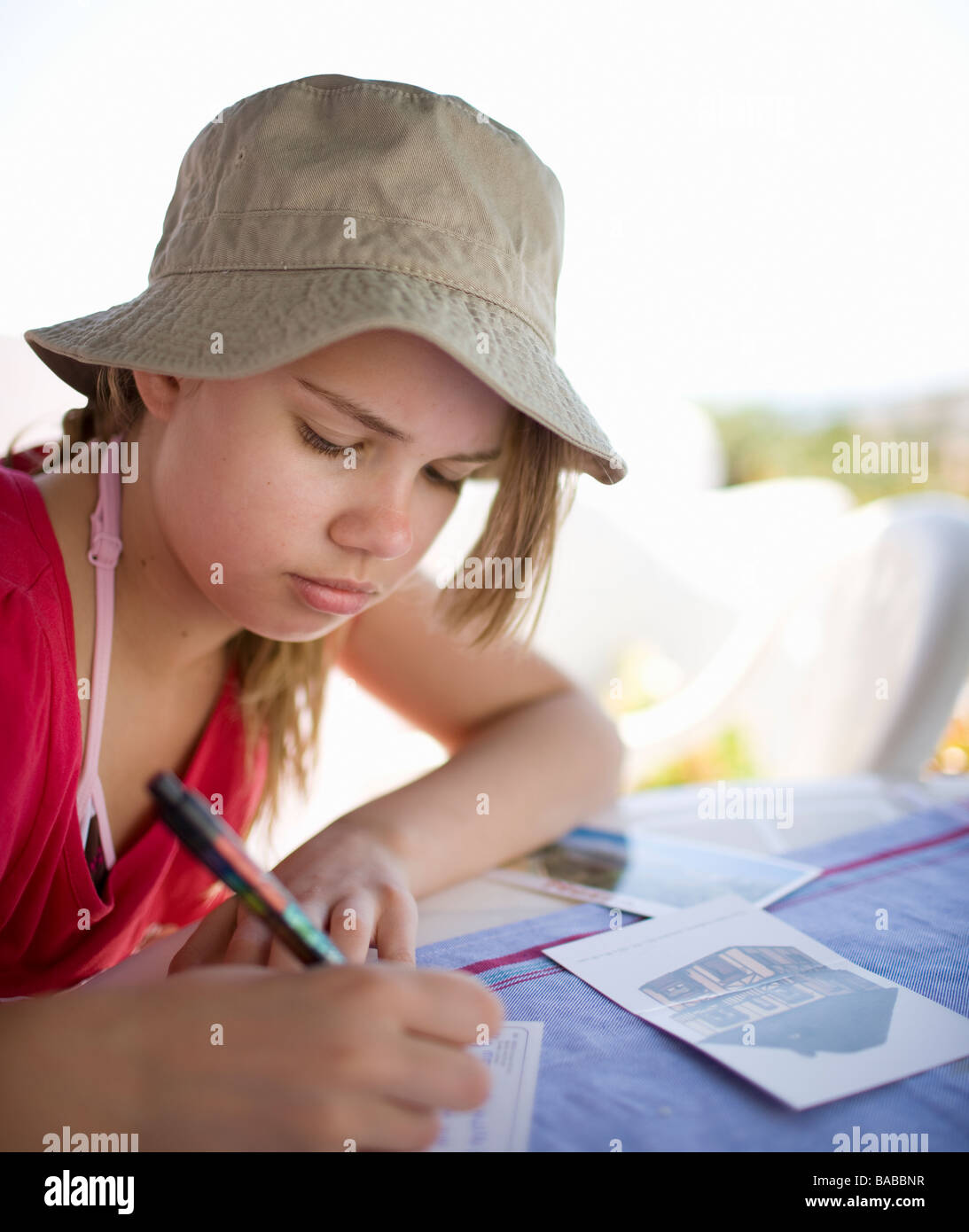 A girl writing a postcard Andalusia Spain. - Stock Image