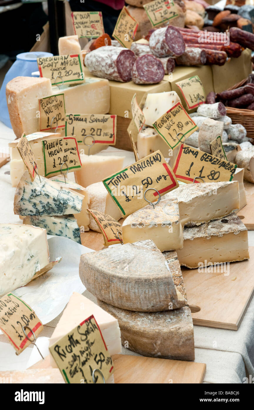 Continental cheeses on market stall in Broadway Market, London, England, UK - Stock Image