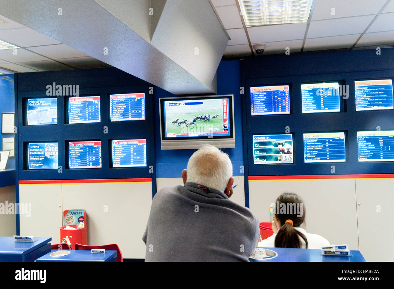 Screens in William Hill betting shop London England UK - Stock Image