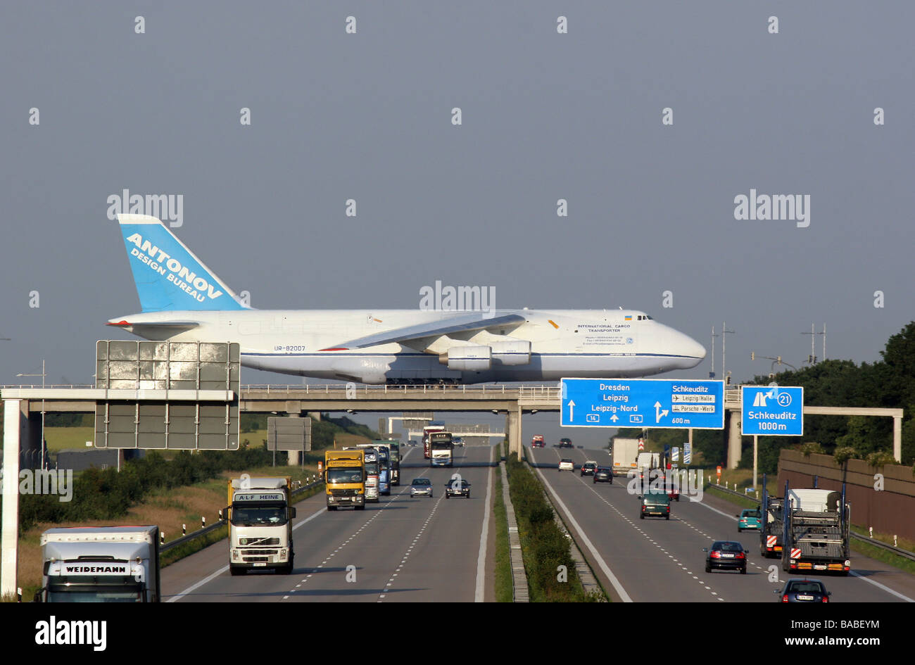 A Plane At The Leipzig Halle Airport Rolling Over A Highway Leipzig Stock Photo Alamy