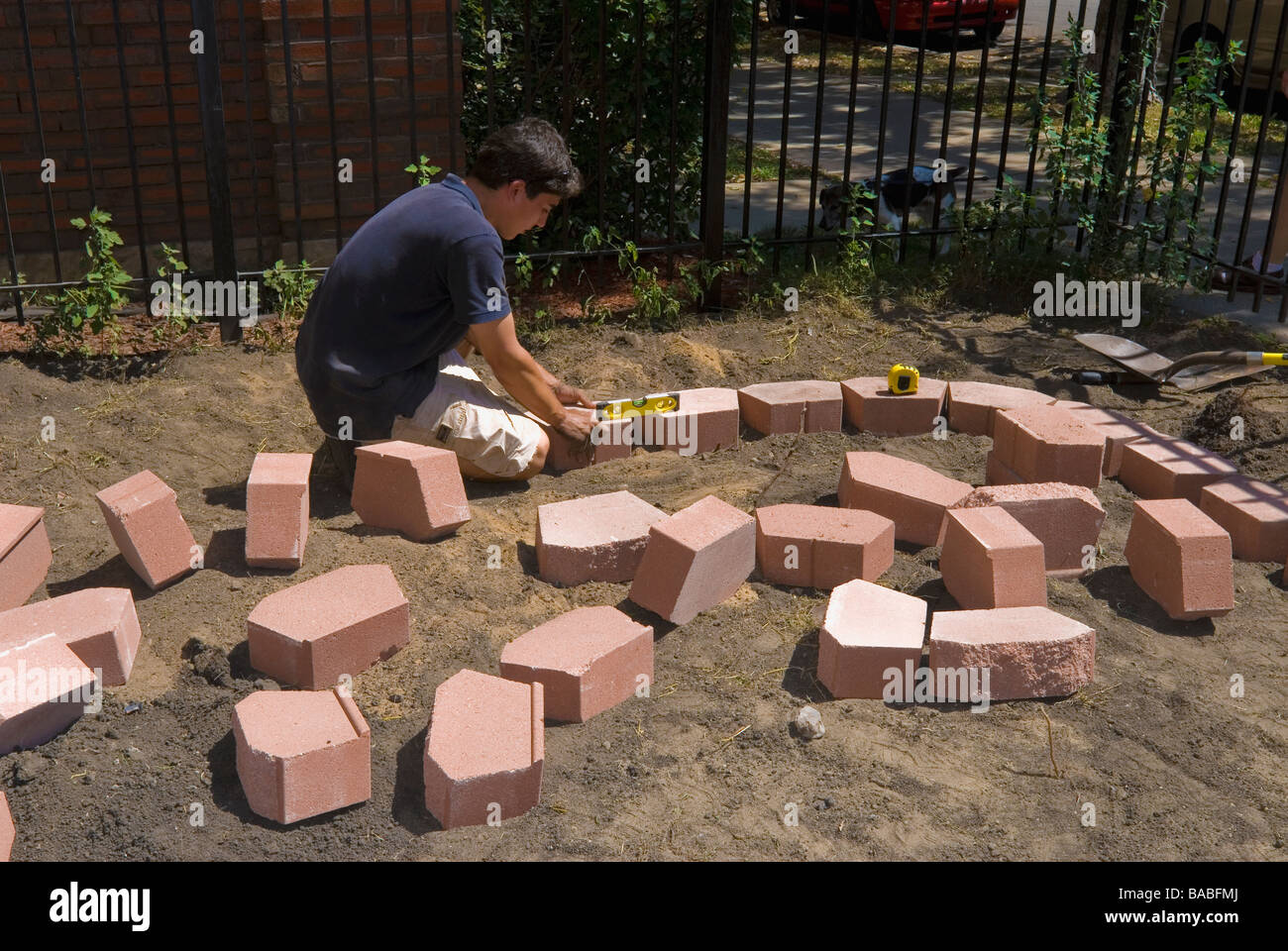 Hispanic italian landscaping architect laying pavers for raised hispanic italian landscaping architect laying pavers for raised flower garden for an apartment building in chicago illinois workwithnaturefo