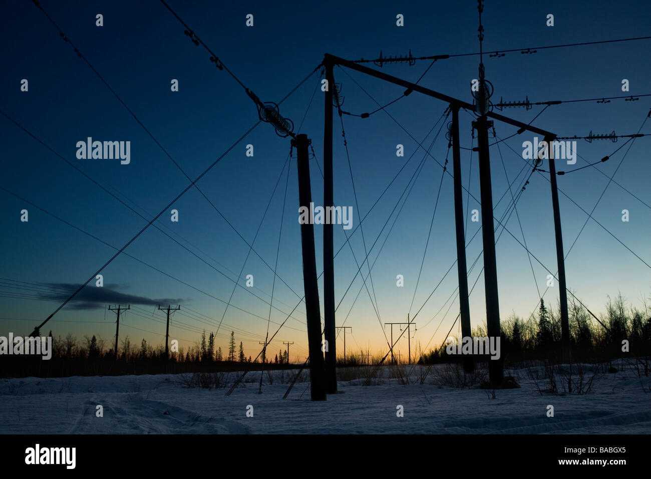 Power lines in the winter Sweden - Stock Image