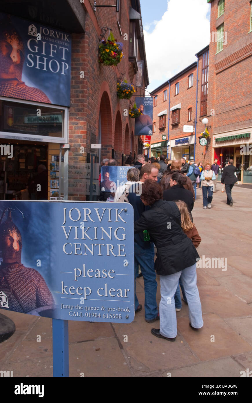 People queing up in a que to visit the Jorvik viking centre museum in York,Yorkshire,Uk - Stock Image