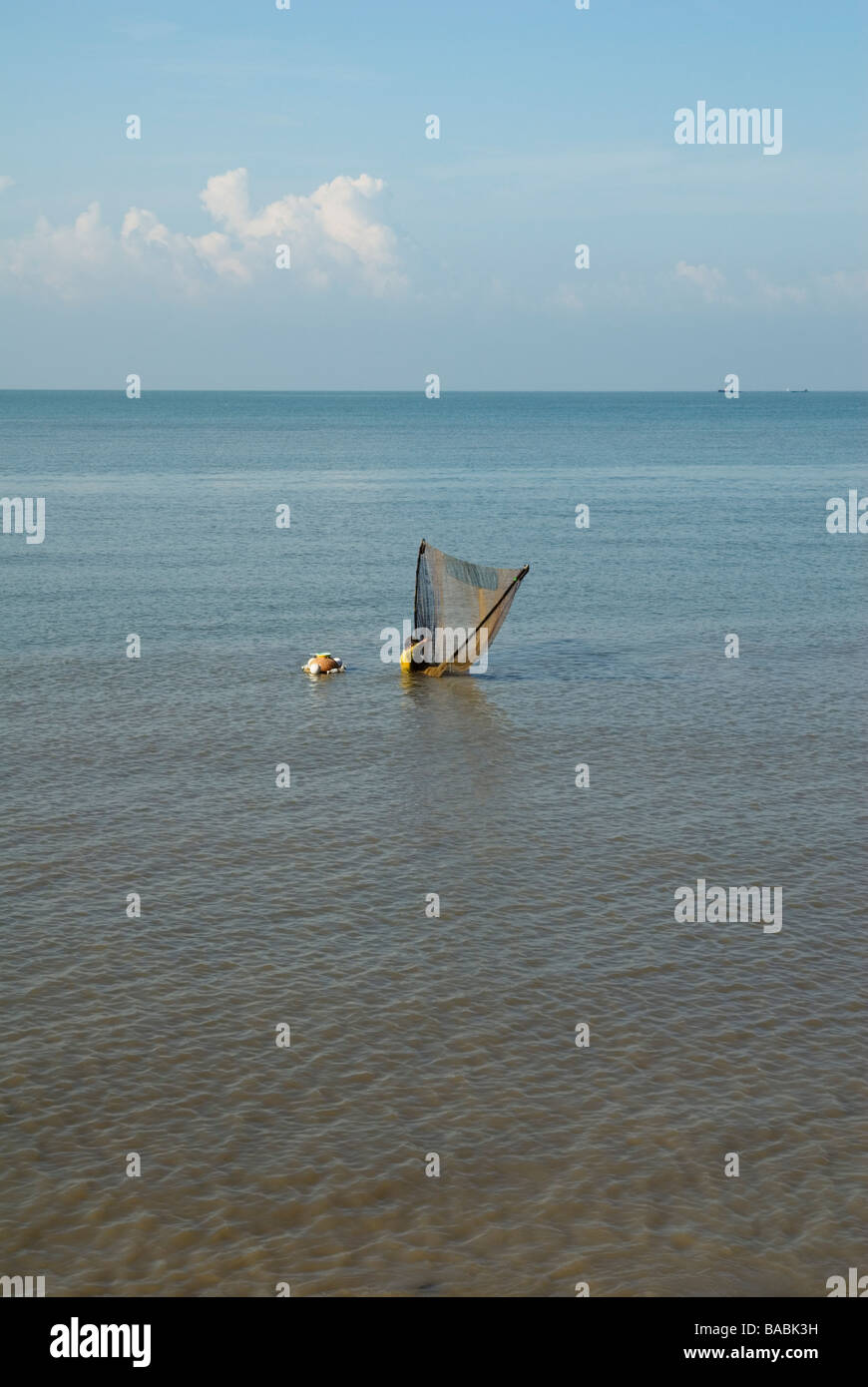 Traditional fishing using a triangular net off the coast of Malacca, Malaysia - Stock Image