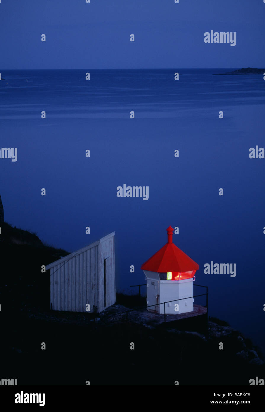 Lighthouse by sea - Stock Image