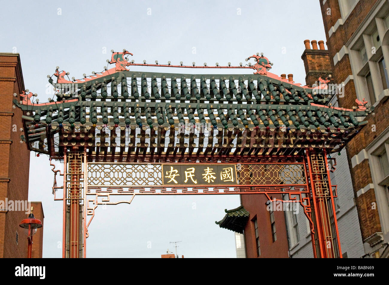 Elaborate gated entrance to London's China Town District, London, England, UK - Stock Image
