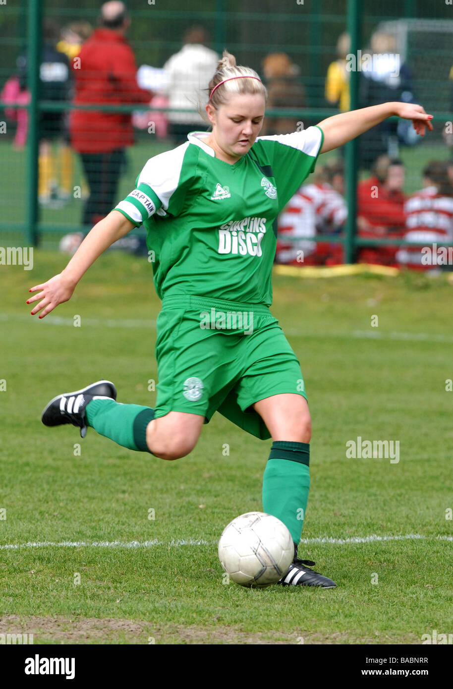Young female footballer in action - Stock Image
