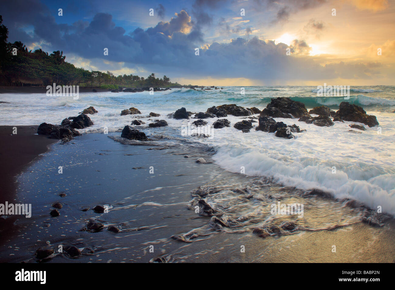 Dramatic sunrise over Hana Bay on the northeast coast of Maui, Hawaii, in the town of Hana - Stock Image