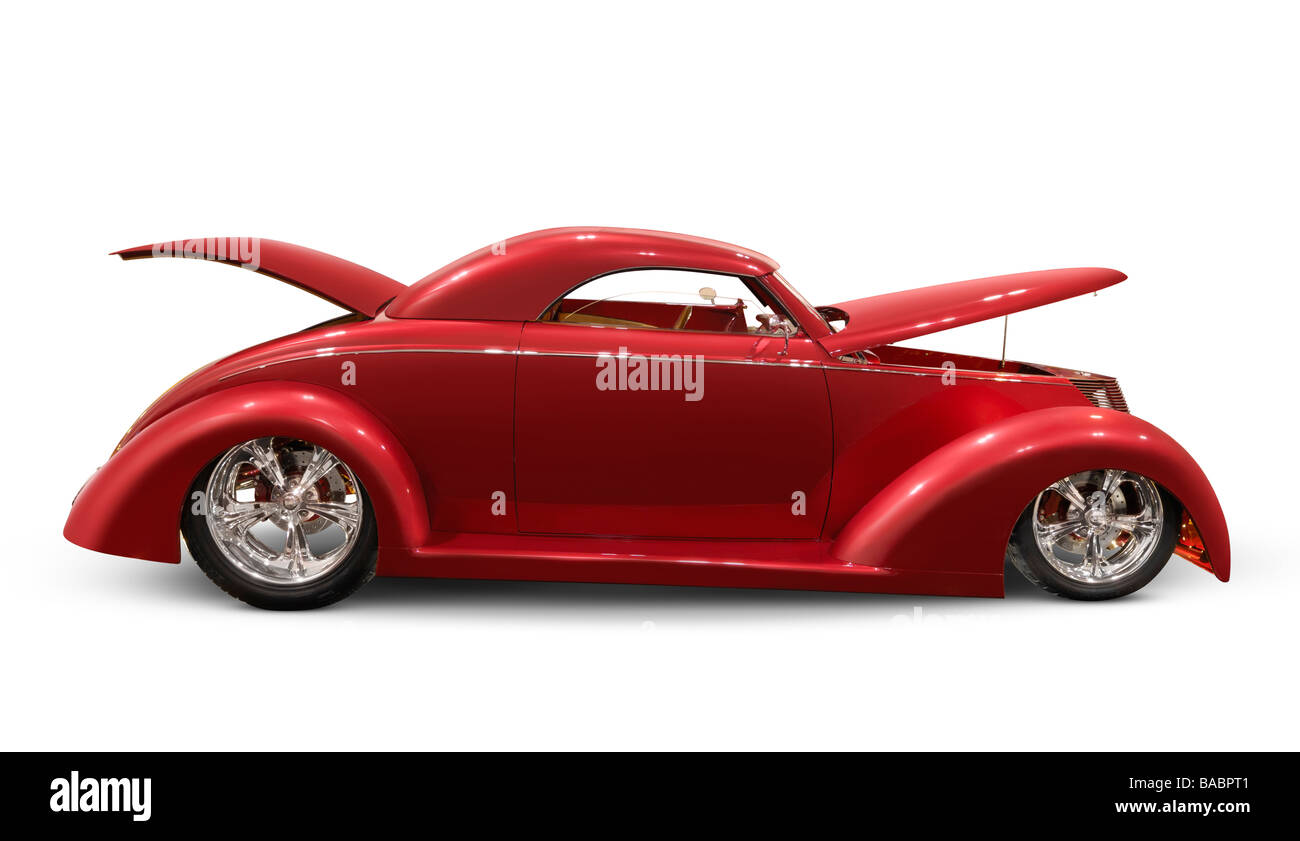 Red classic car with open hood and trunk - Stock Image