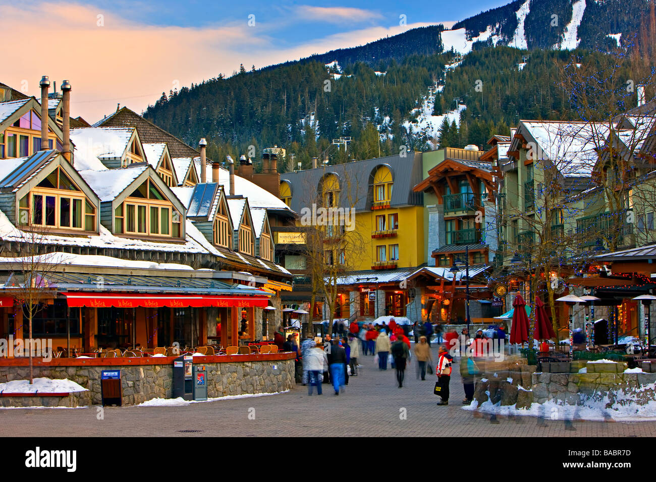 Pedestrian activity and shops along along the Village Stroll in Whistler Village British Columbia Canada - Stock Image