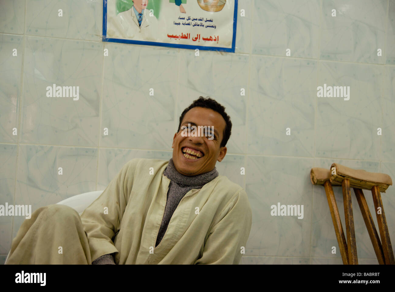 A young leper is waiting for his medical treatment at Egypt's biggest leprosy hospital. He lost half of one - Stock Image