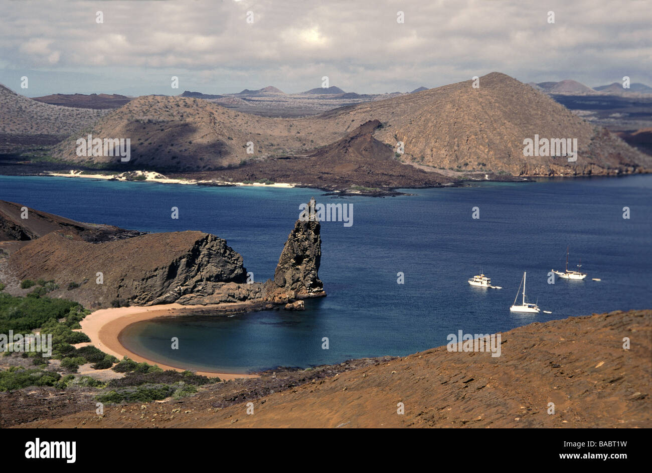 Galapagos Islands. Bartholomew Island.View from top of the island past Pinnacle Rock towards James Island. - Stock Image