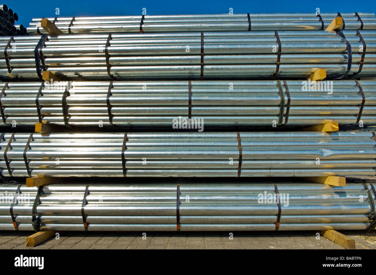 pipework plumbing iron steel tube pipe duct tubes in mill lengths sell seller stor storage industry trade tarding - Stock Image