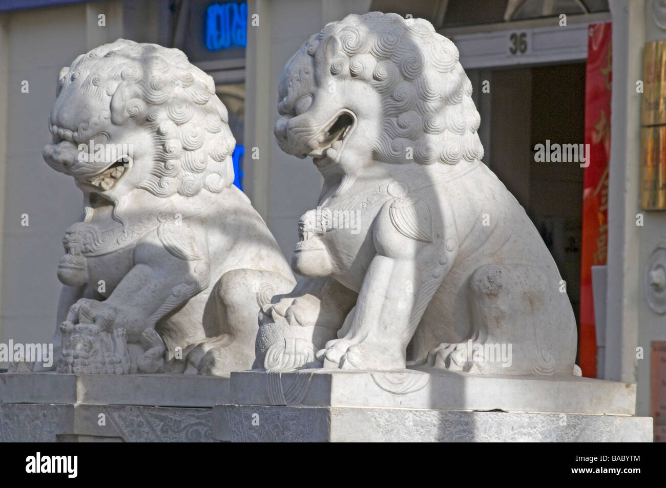 Stone dragon Statues in London's China Town, London, UK - Stock Image