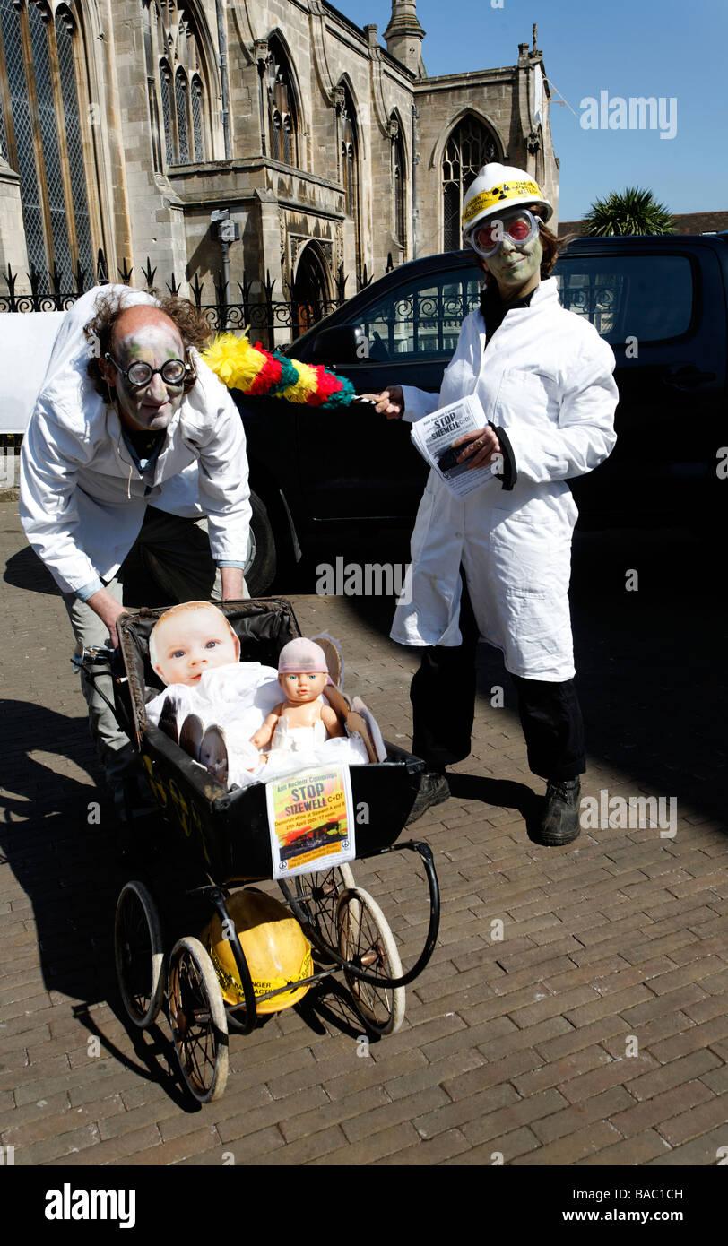 Anti nuclear protestors street theatre dressed as mad scientist mutants - Stock Image