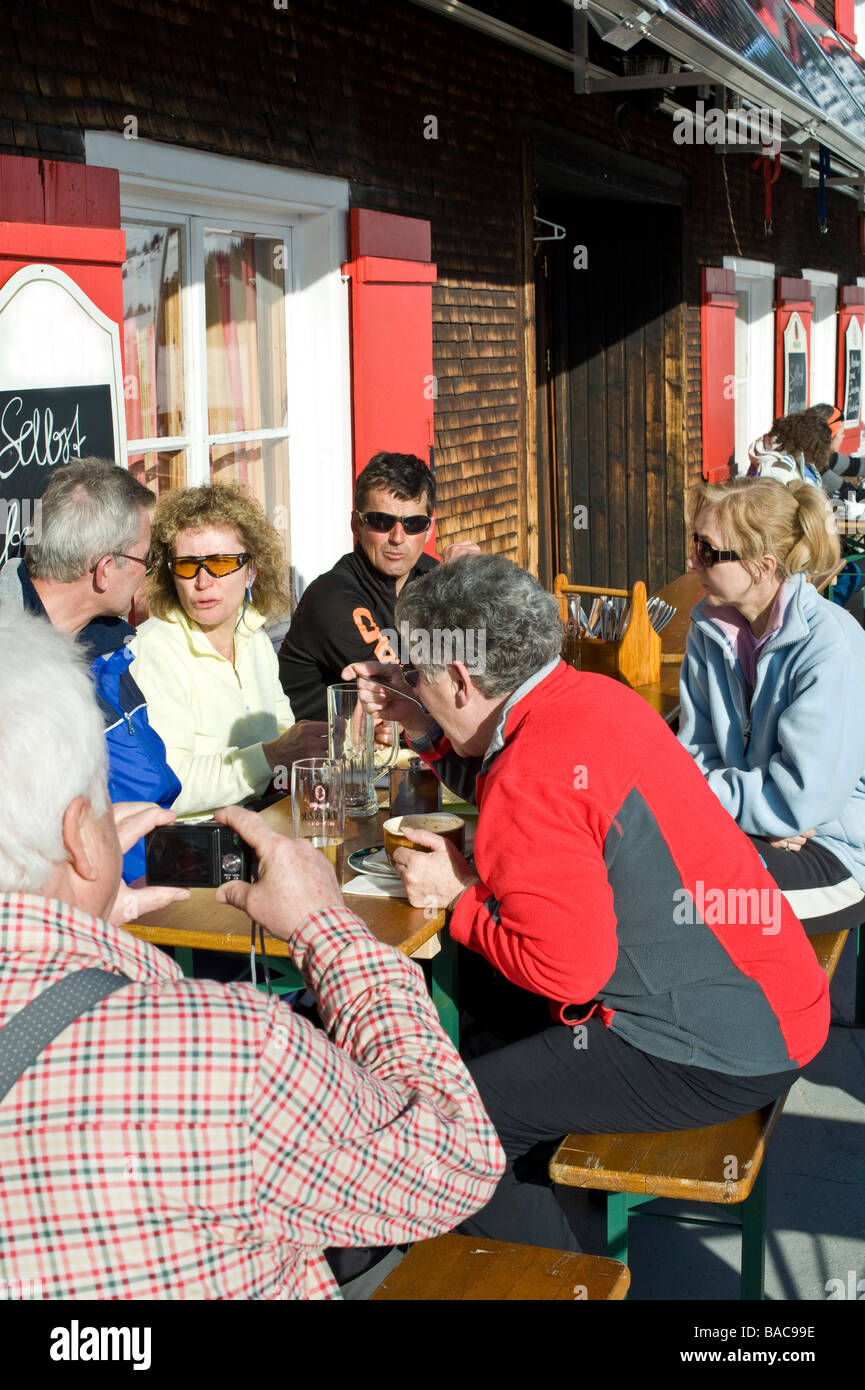 Group at a snack in the Neuhornbach hut in the Bregenz Forest - Stock Image