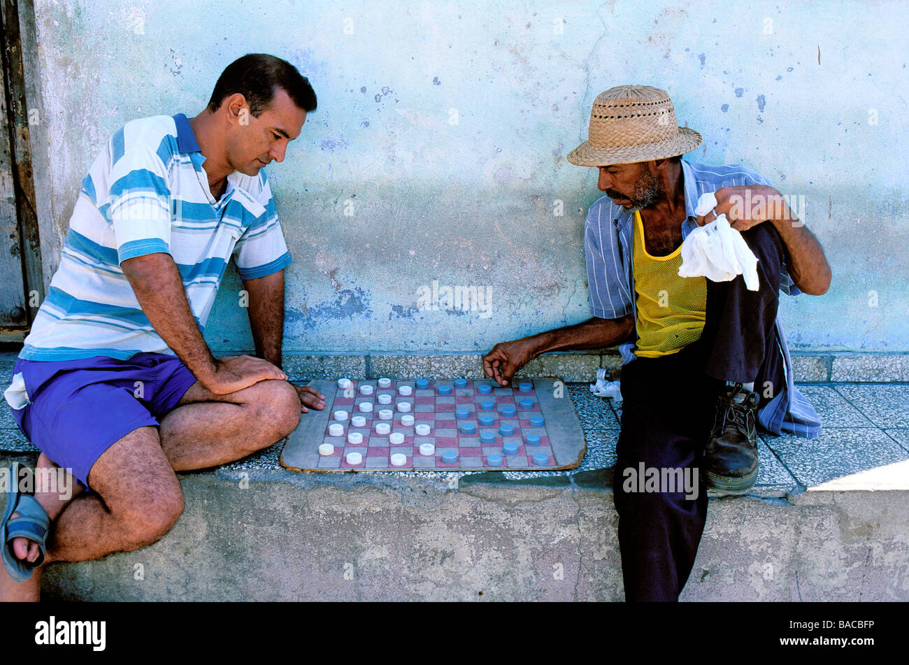 Cuba, Santiago de Cuba, draughts players in the Tivoli old French District - Stock Image