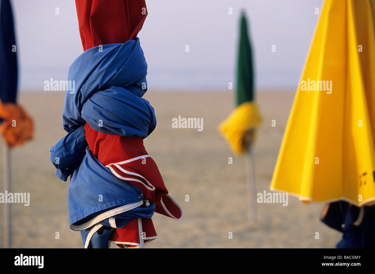 France, Calvados, Pays d'Auge, Deauville, sunshades on the beach - Stock Image