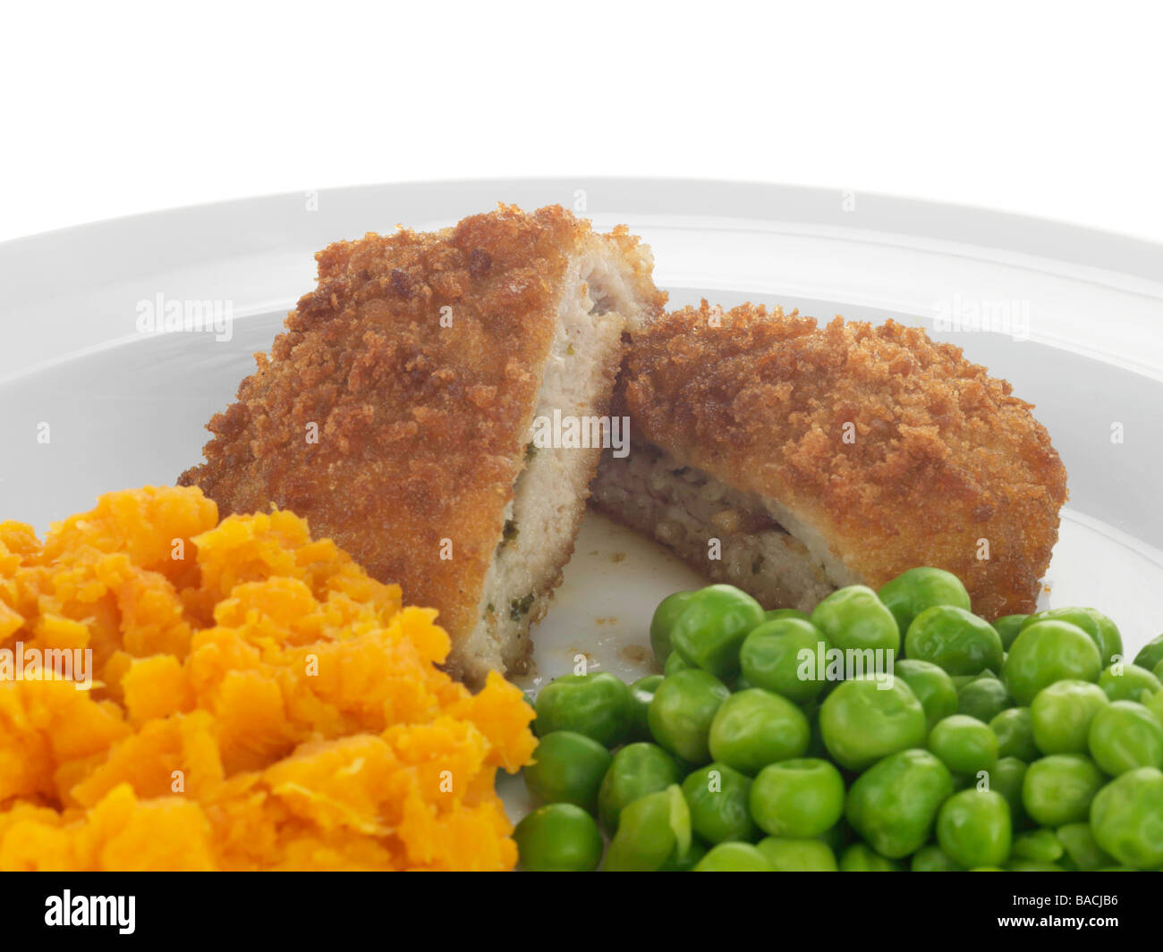 Chicken Kiev with Vegetables - Stock Image