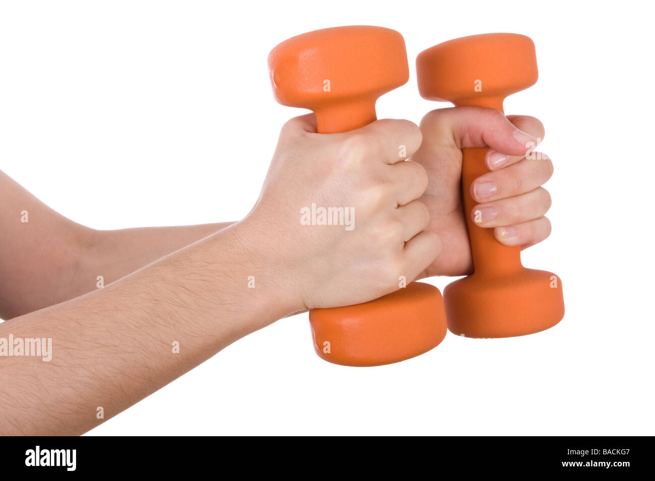 Female hands holding dumbbells isolated on white background - Stock Image