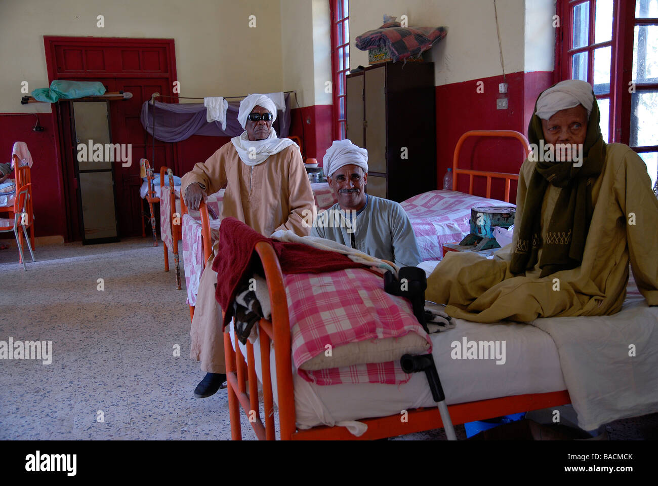 Three leprosy patients in Egypt's leprosy colony Abu Zaabal are gathering in their sleeping ward in the hospital - Stock Image