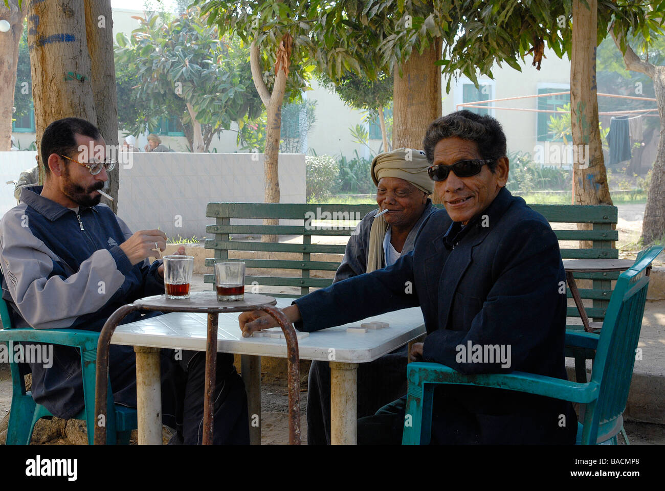 Three leprosy patients are playing domino in the hospital garden in Egypt's leprosy colony Abu Zaabal - Stock Image