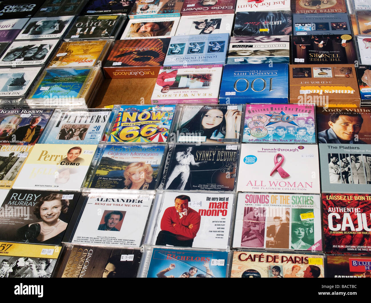 A display of popular 1960s music CDs on a market stall Stock