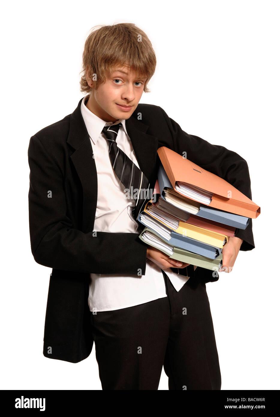 Schoolboy carrying folders - Stock Image