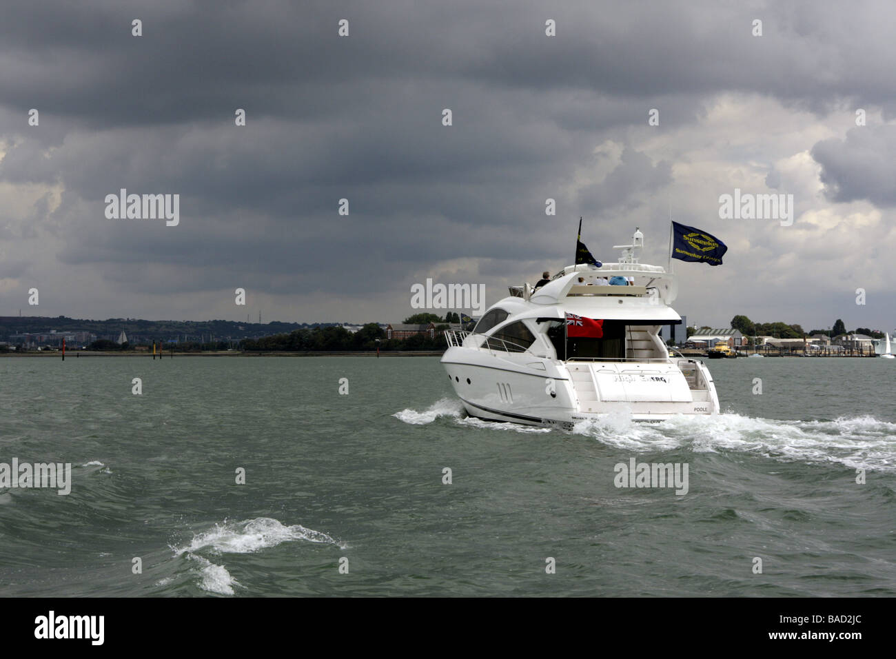 A fast powerboat entering dark and stormy waters in Portsmouth harbour - Stock Image