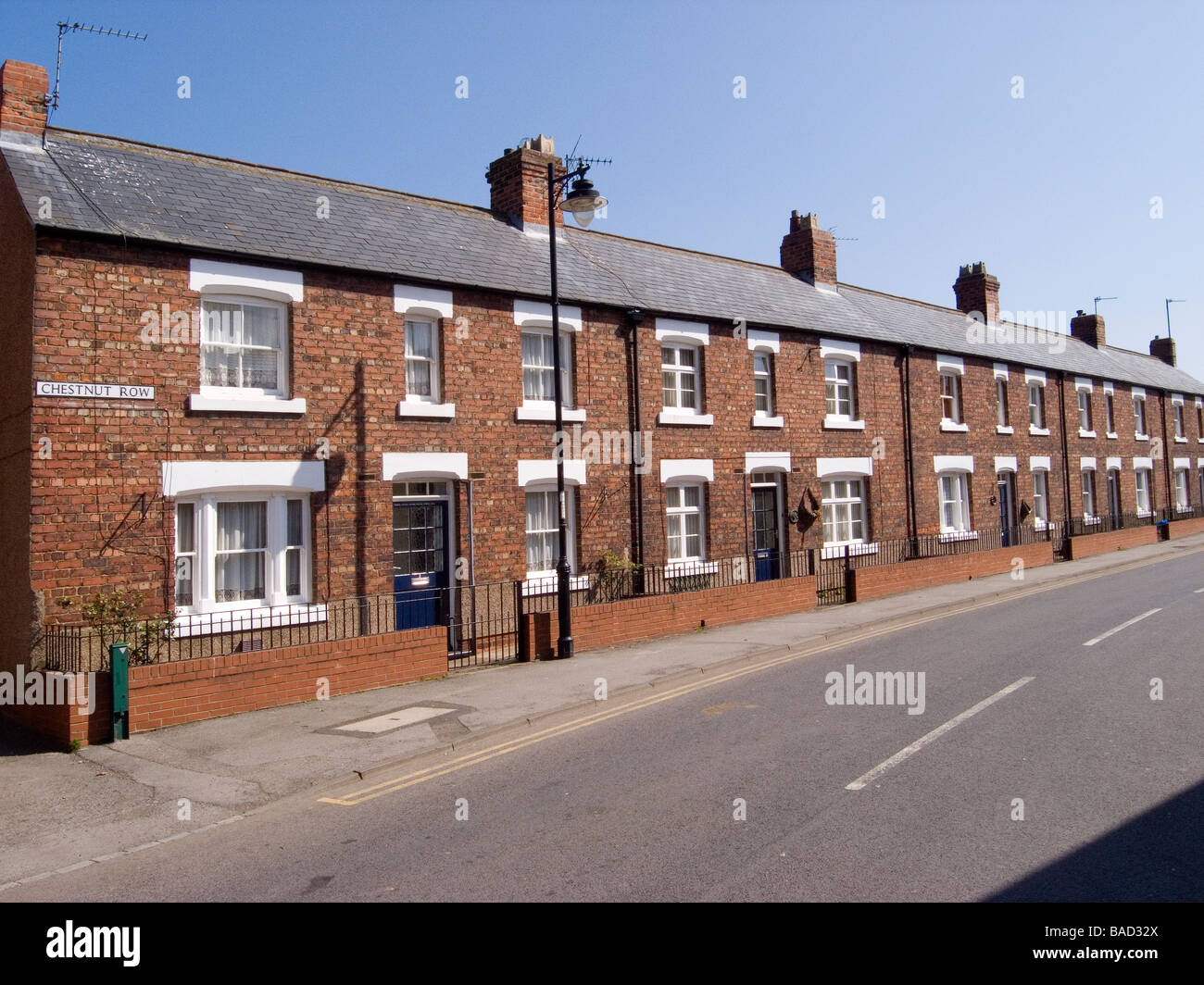 Chestnut Row, a row of substantial well built double fronted terraced houses in Greatham, Co. Durham - Stock Image