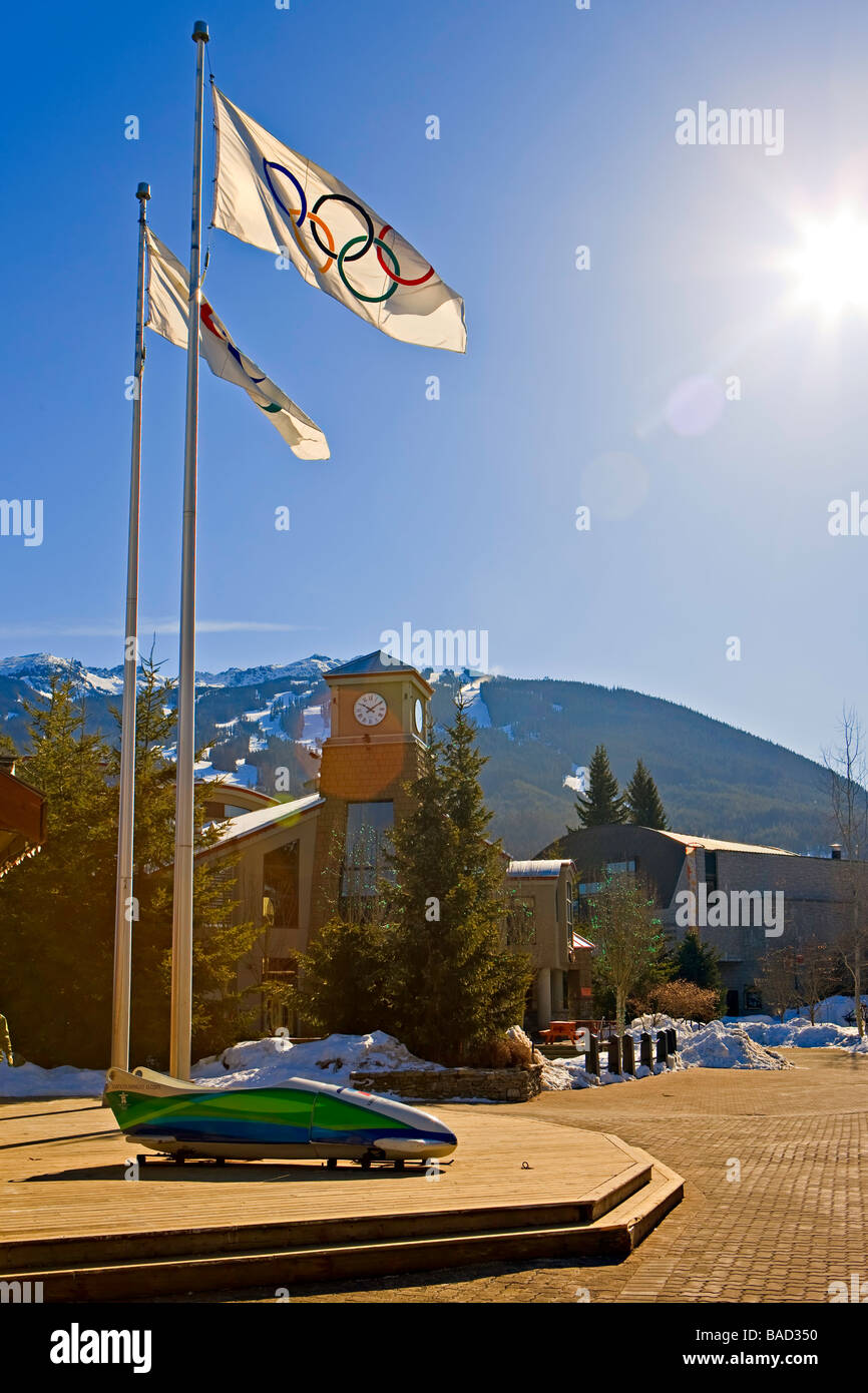 Olympic flags and bobsled,Whistler Village,Canada. - Stock Image