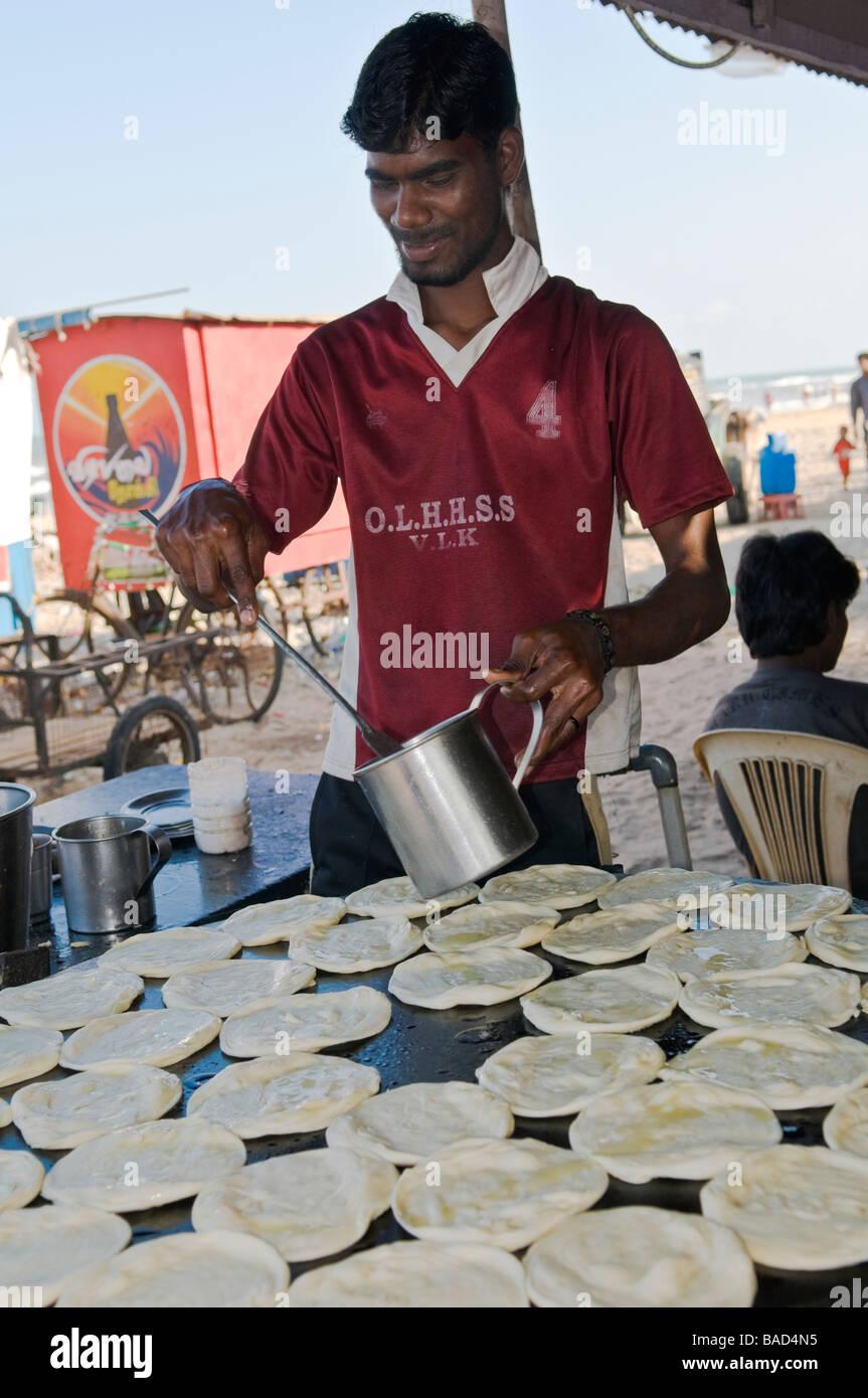 Man making parathas Velankanni Tamil Nadu India Stock Photo