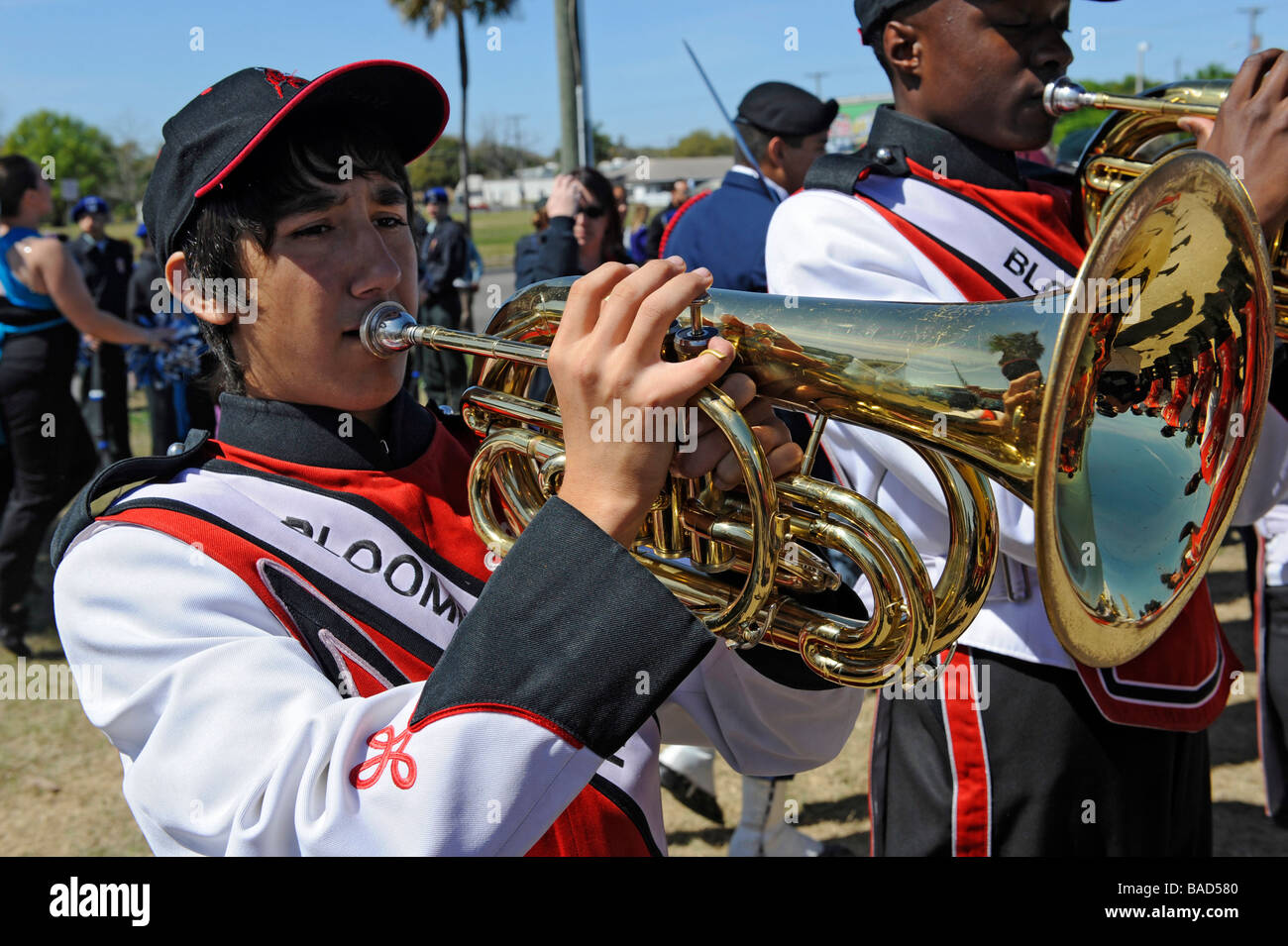 High School Band Member plays french horn at Strawberry Festival Parade Plant City Florida - Stock Image