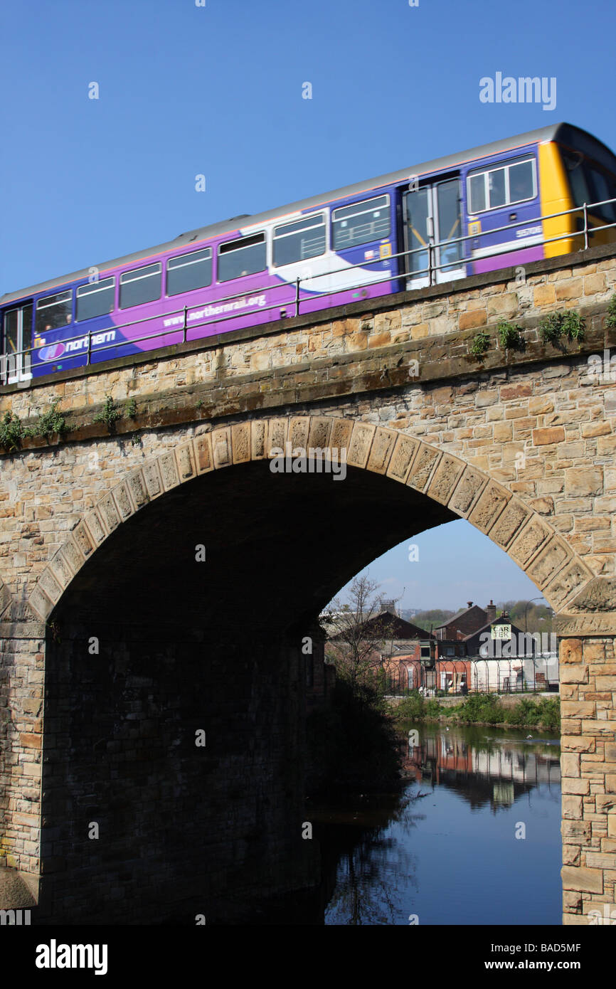 A Northern Rail train on a bridge over the River Don, Sheffield, South Yorkshire, England, U.K. - Stock Image