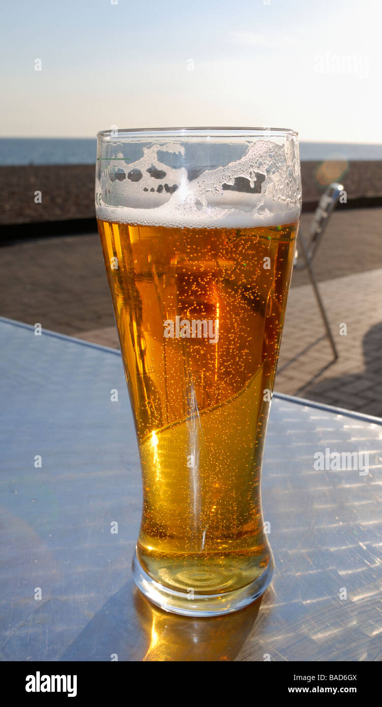 A pint of lager outside in the sun - Stock Image