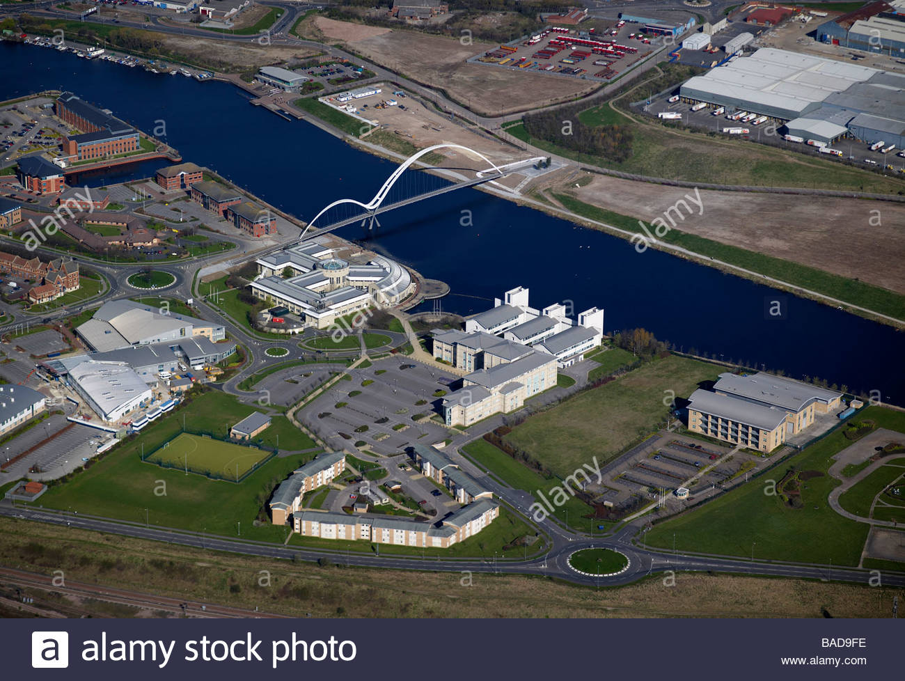River Tees at Stockton upon Tees, North East England, showing the new Infinity pedestrian bridge and Queens University - Stock Image