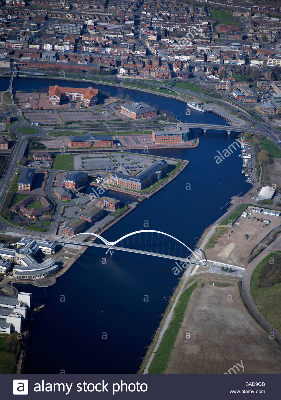 River Tees at Stockton upon Tees, North East England, showing the new Infinity pedestrian bridge and the tees develoment - Stock Image
