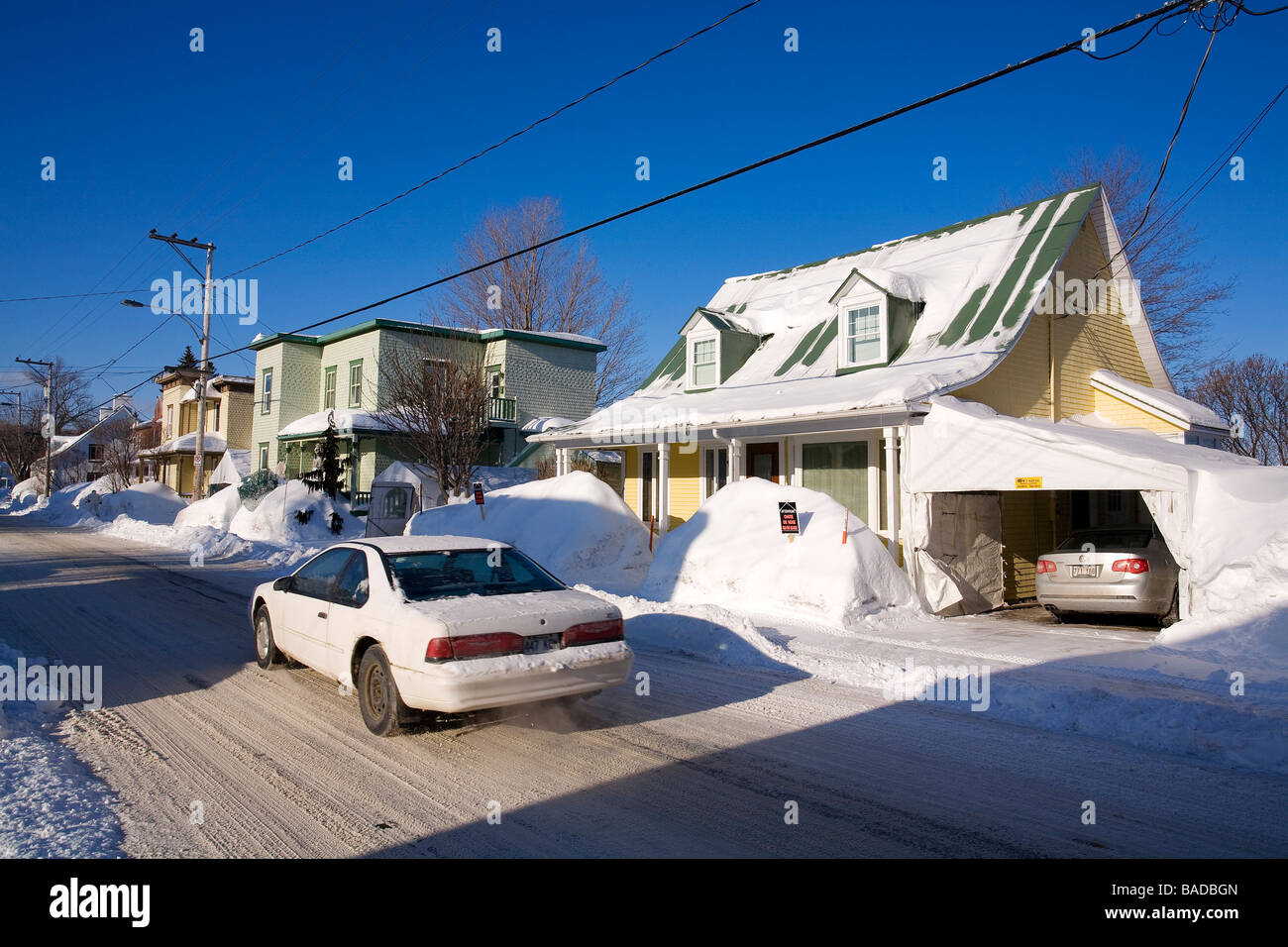 Canada, Quebec Province, Quebec City, Saint Romuald, snow covered houses and roofs Stock Photo