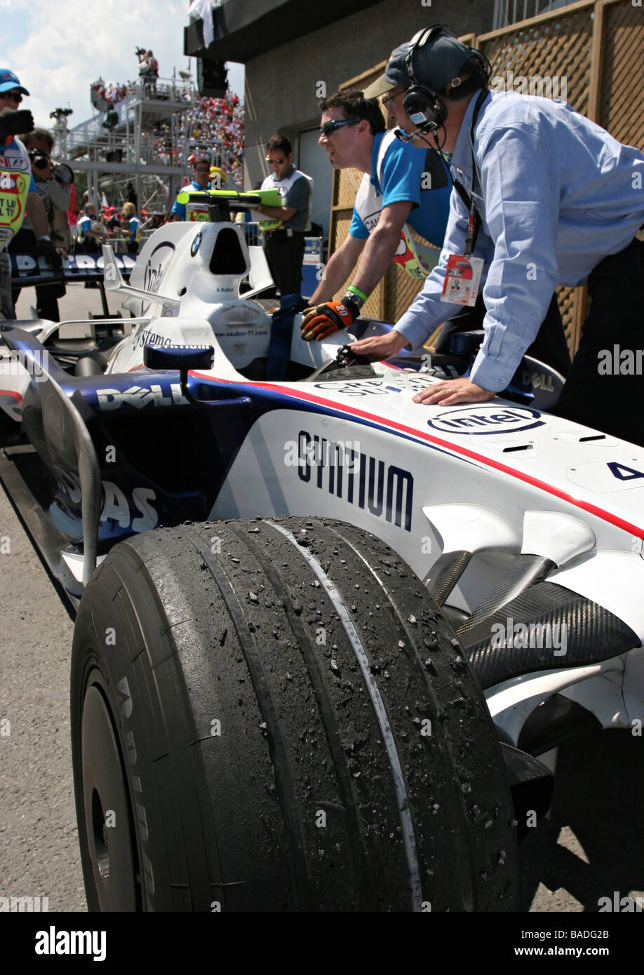 Worn tires on Robert Kubica`s racing car after victory at 2008 F1 Canada Grand Prix - Stock Image