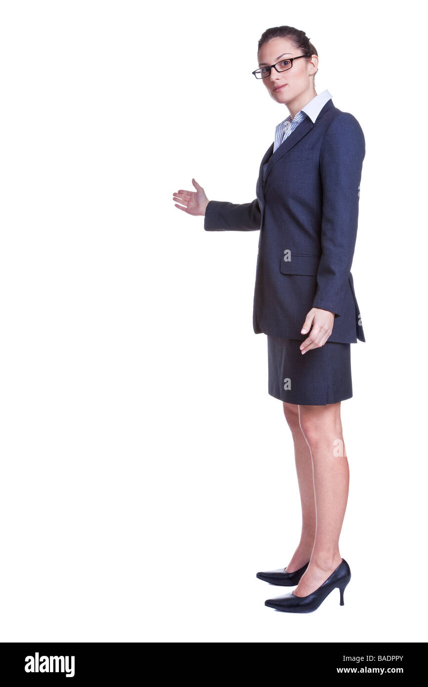 Businesswoamn with her arm out in a welcoming gesture isolated on white background - Stock Image