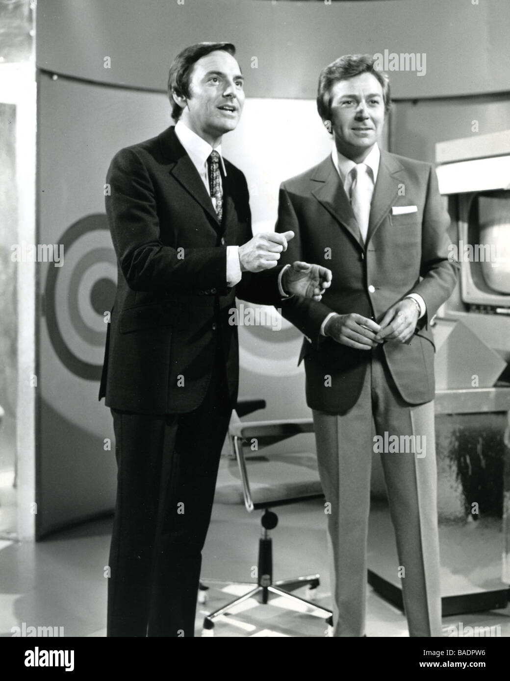 THE GOLDEN SHOT 1960s UK TV game show with compere Bob Monkhouse at left and singer Lionel Blair - Stock Image