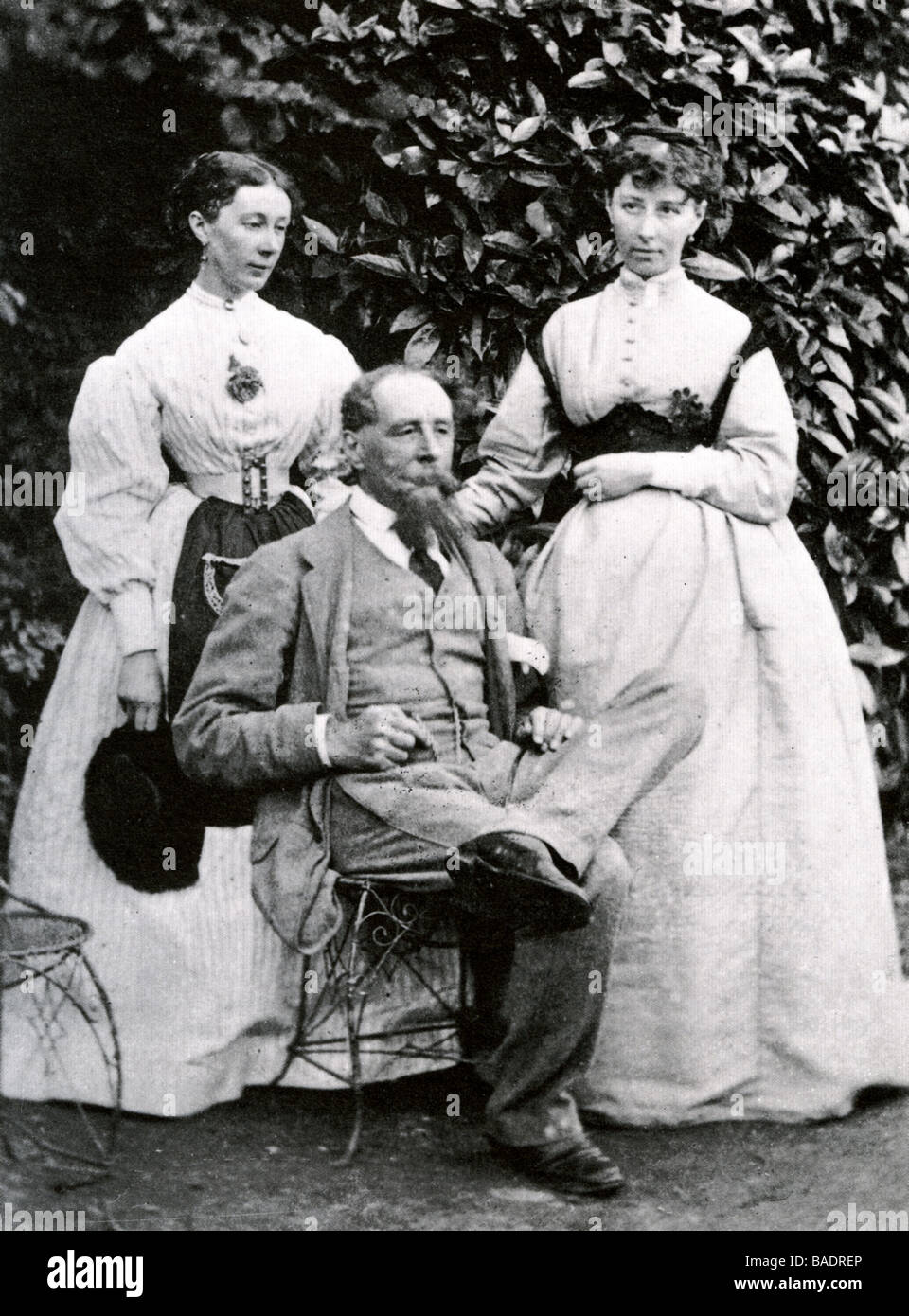 CHARLES DICKENS with his daughters Mamie and Katey at Gads Hill Place in 1866 - Stock Image