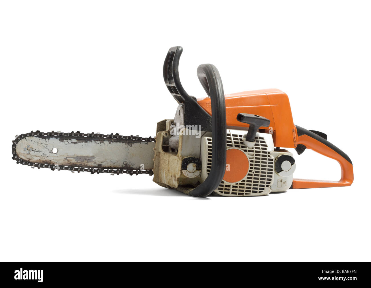 Old petrol chainsaw on white background Stock Photo