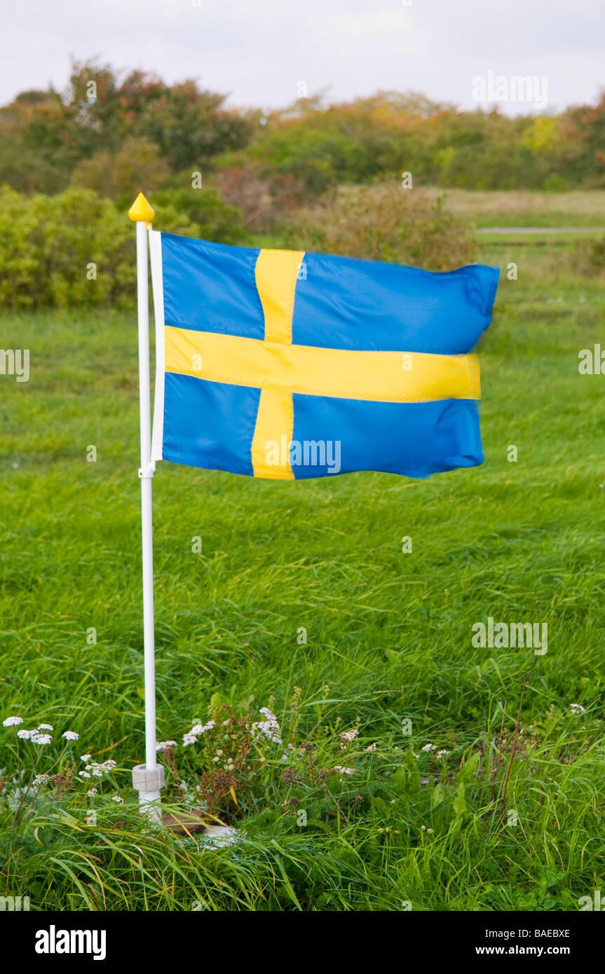 Small Swedish flagpole. - Stock Image