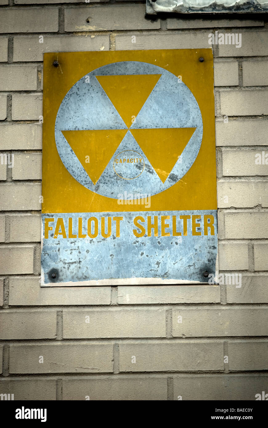 A Fallout Shelter sign circa 1963 on the side of a school in Harlem in New York Stock Photo