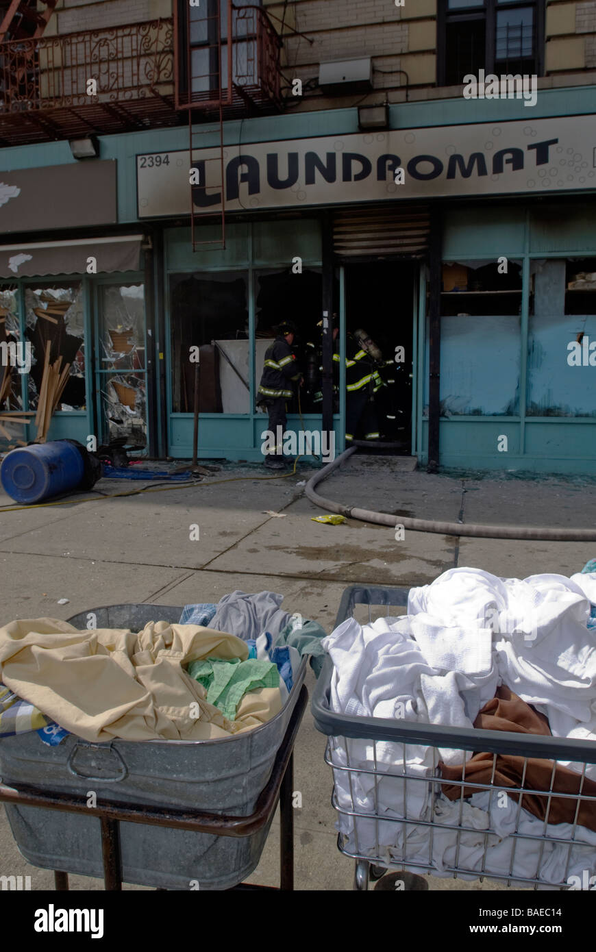 FDNY firefighters at an all hands fire in a laundromat in Harlem in New York - Stock Image