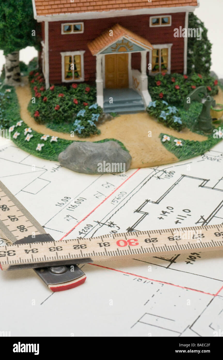 Toy house on a floorplan. - Stock Image
