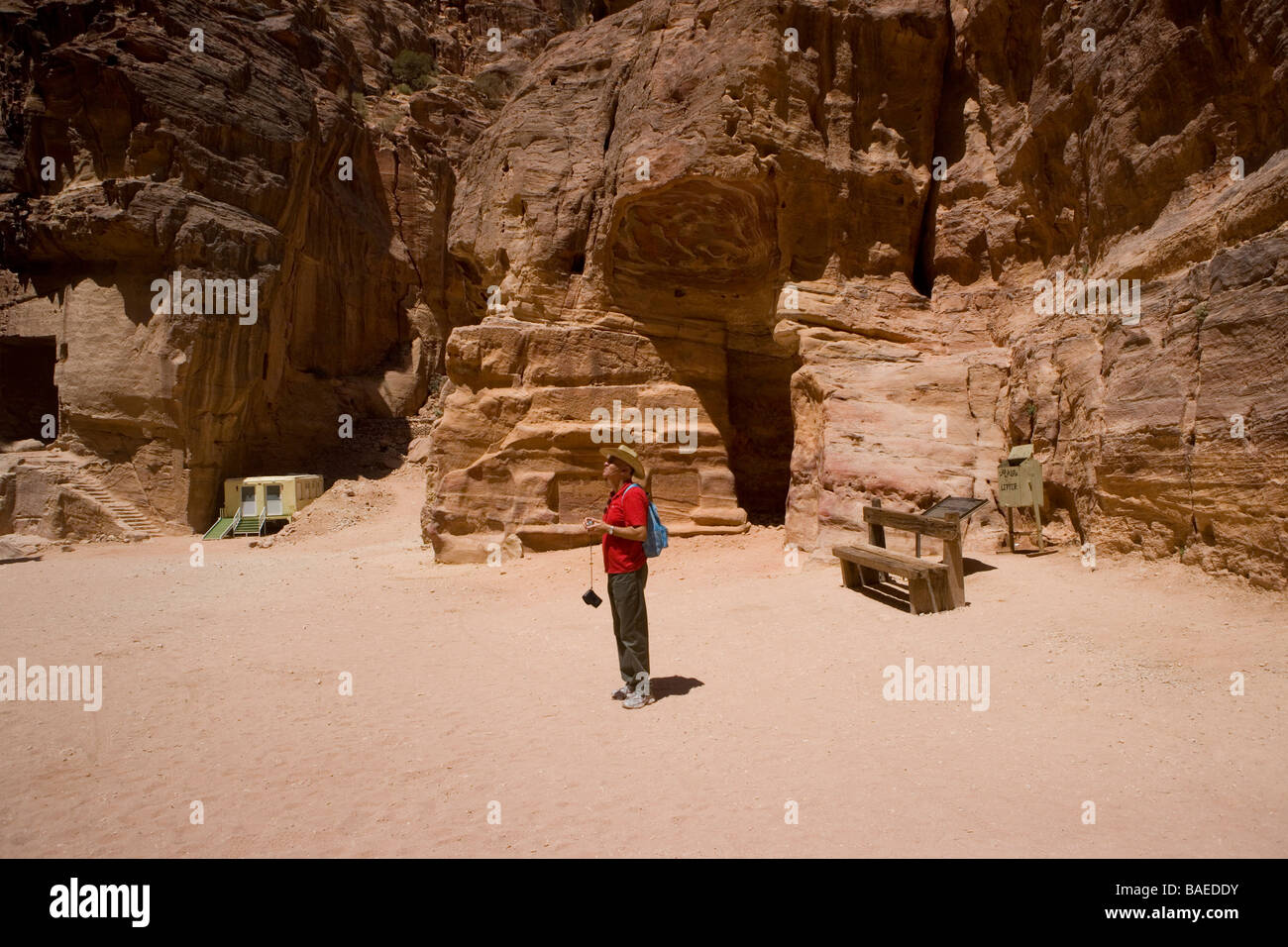 A tourist looking at The Treasury, the most famous building in the ancient city of Petra, Jordan Stock Photo